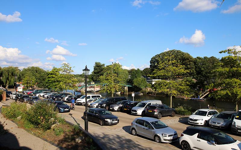 Car park on Twickenham riverside, from Sunshine cafe, overlooking river.