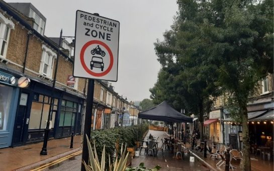 Old York Road with a pedestrianised zone sign and outdoor seating