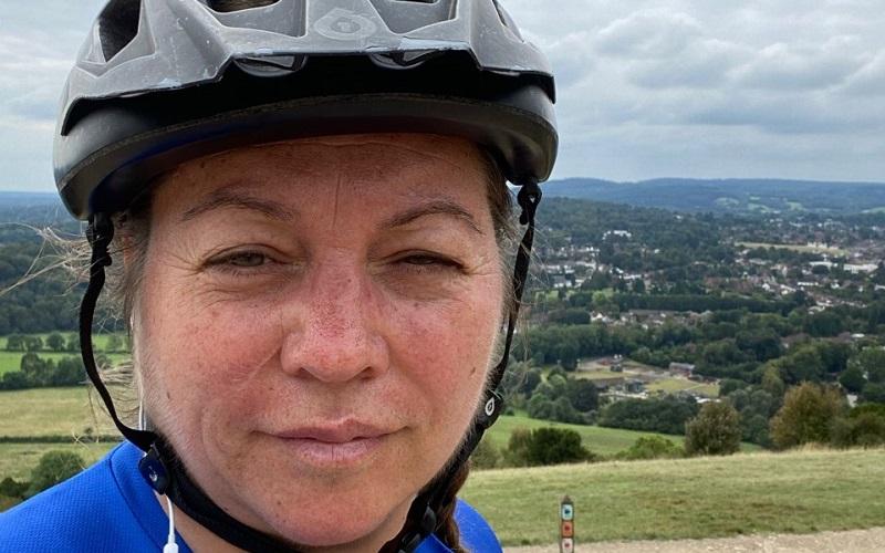 Female cyclist, Samantha Drew smiles at camera