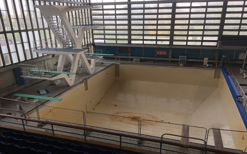 A diving pool drained of its water