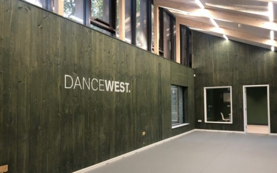 DanceWest's logo on the wall at its new studio space