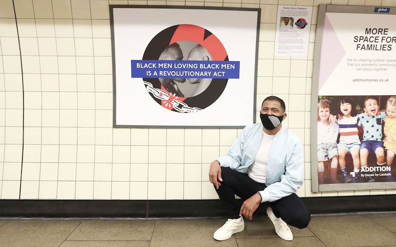 Marc Thompson with his Pride roundel in Brixton Underground station.