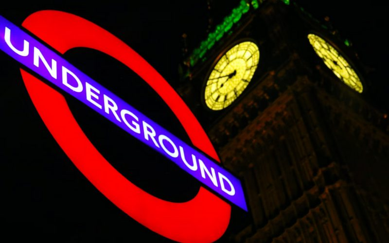 Photo of a London Underground sign and Big Ben at night