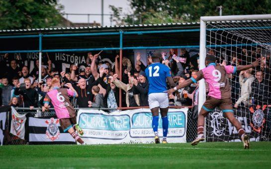 Alfie Bendle celebrates in front of Corinthian-Casuals' fans