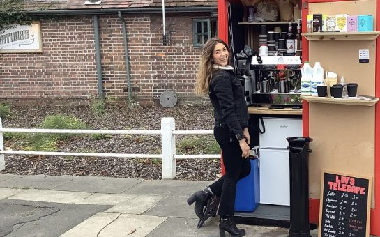 Liv with her coffee shop telephone box
