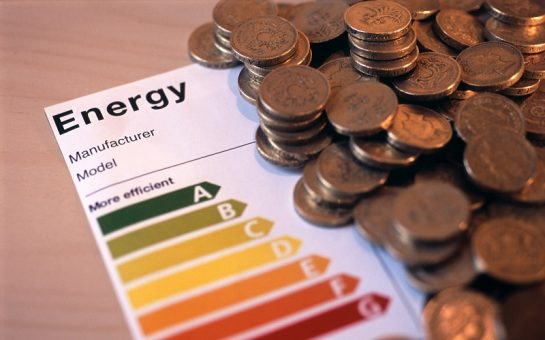 image of an appliance energy efficience rating label and a pile of uk money