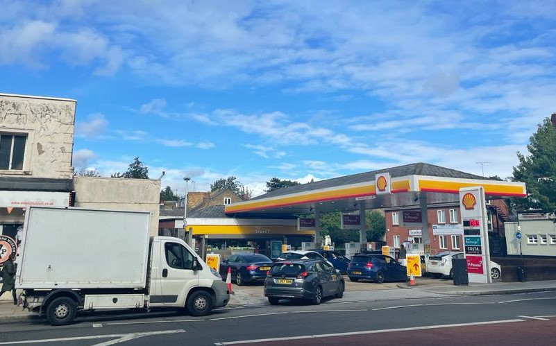 Several cars and a white van crowd the forecourt at a Shell petrol station in Twickenham